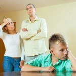 teenager son and parents after quarrel at home