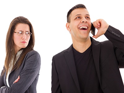 jealous suspicious woman looking at unfaithful man talking with