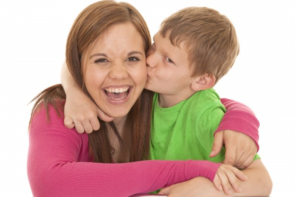Girl and young boy kiss her laugh