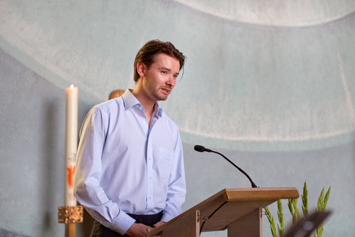 Young man preaching in christian catholic church