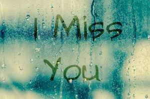 "natural water drops on glass window with the text ""I miss you"""