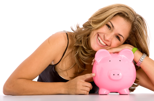 casual woman looking to save money in a piggy bank