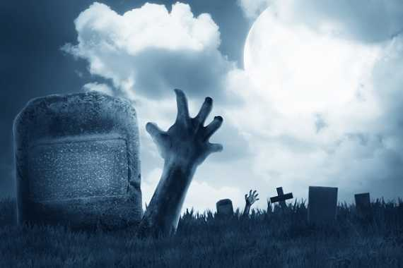 Zombie hand out from the graveyard. Halloween concept
